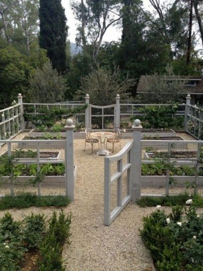 Vegetable garden with gravel surrounding vegetable boxes