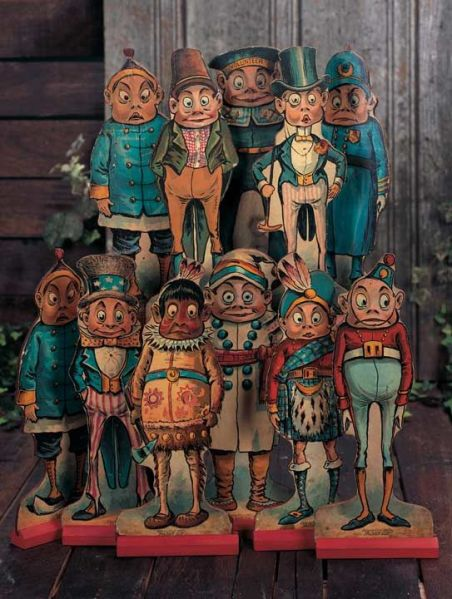 """American Lithographed-Paper-over-Wood Brownies with Original Stands  12"""" (30 cm.) The flat die-cut wooden figures have lithographed-paper cover to depict the various Brownie characters,along with original red wooden slot bases for display that appeared in the various Palmer Cox books. Each marked """"copyrighted 1892 by Palmer Cox"""".:"""