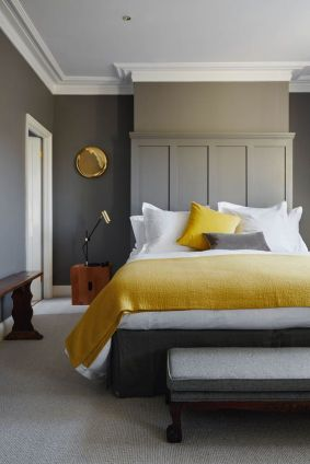 Using yellow as a pop of colour in an otherwise neutral room