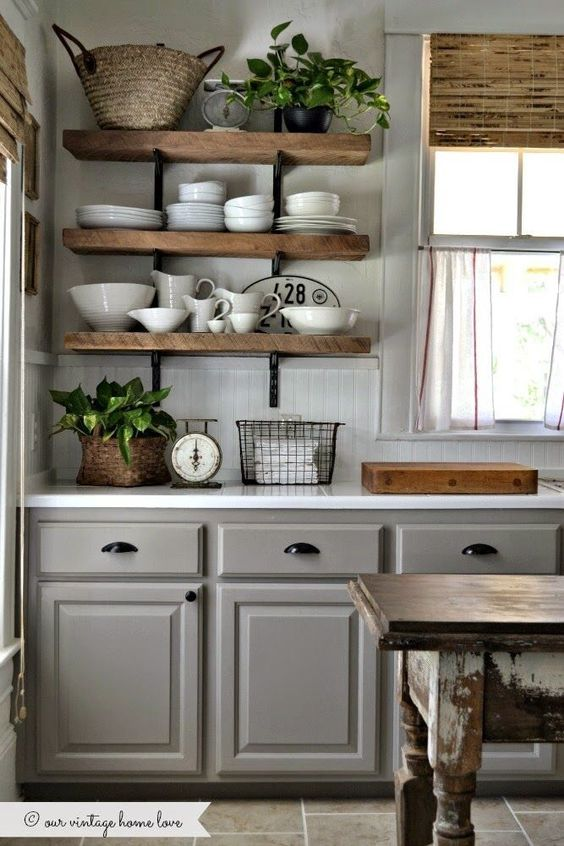 We love this kitchen. Lovely selection of rustic neutrals with a few plants for color and life. Great shelving!: