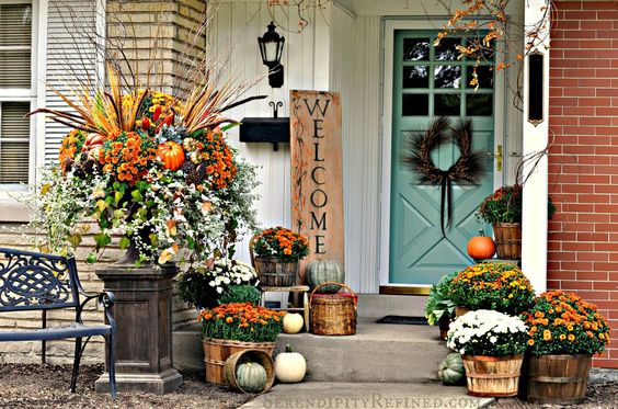 Lack of a full porch should not stop you from decorating for fall. To maximize space, line your steps with bundles of seasonal items, like mums or pumpkins.: