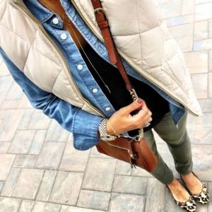 flats, olive jeans, black tee, chambray button-down, white puffer vest, cross-body bag, long necklace: