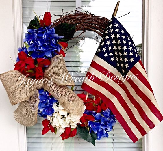 Make these 10 gorgeous yet easy patriotic wreaths that will brighten up your home, perfect for Memorial Day, 4th of July, and other patriotic holidays. - lovely patriotic wreath with flowers and flag