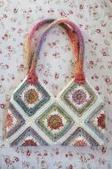I had great time with this pattern from The Perfect Knot, the Granny Square she wrote up is a perfect square, and I love perfect geometrics. This purse worked up very quickly too and testing the pattern for her pushed me to get it completely finished, thank goodness, because my life can currently be defined as a collection of works in progress.: