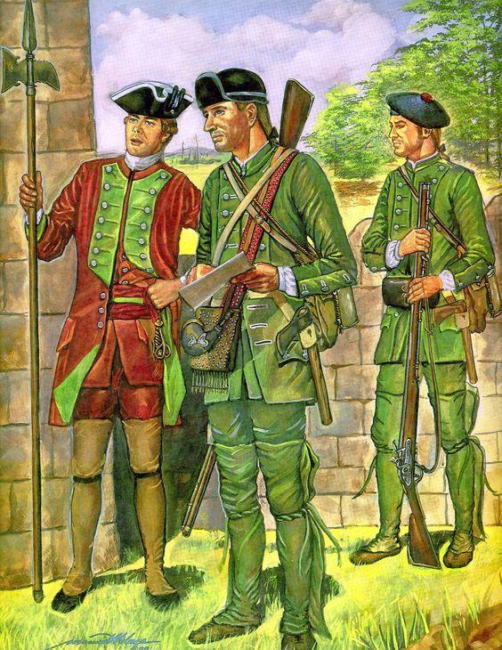 Un sergent de l'armée régulière britannique et un sergent des Rangers déplorent l'absence de Google map pour leur secteur pendant qu'un Ranger attend ses ordres (image U.S. Army).