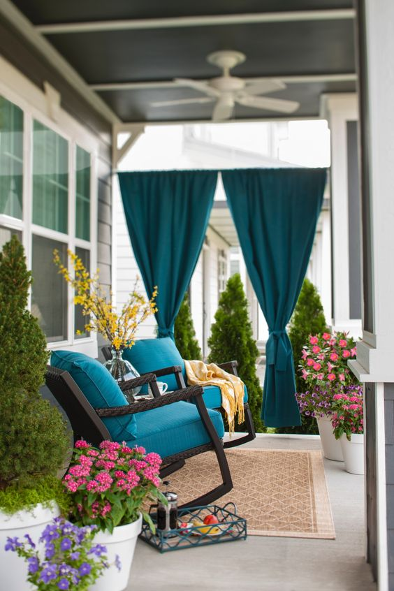 Add privacy to your porch with panels of rich blue Sunbrella outdoor fabric.: