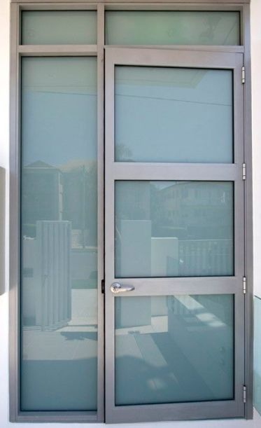 Aluminium entrance door to unit block - completed by the team at Central Glass and Aluminium 2013 - glazed in white translucent laminate:
