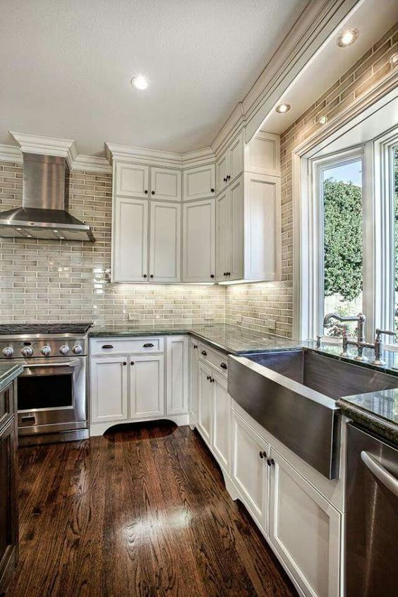 Ivory cabinets dark floor: