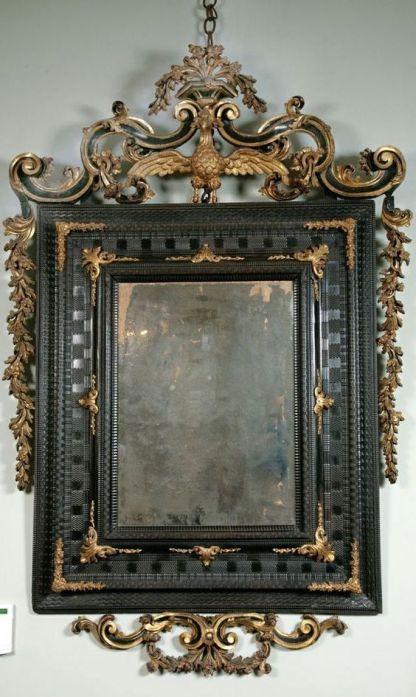 An Early 18th Century Venetian Ebonised & Parcel Gilt Mirror.: