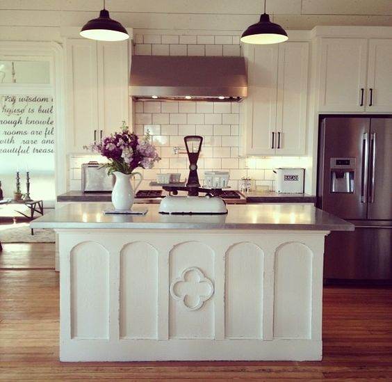 love the white on white with the cement countertops the island is gorgeous joanna gaines on kitchen layout ideas with island joanna gaines id=90397