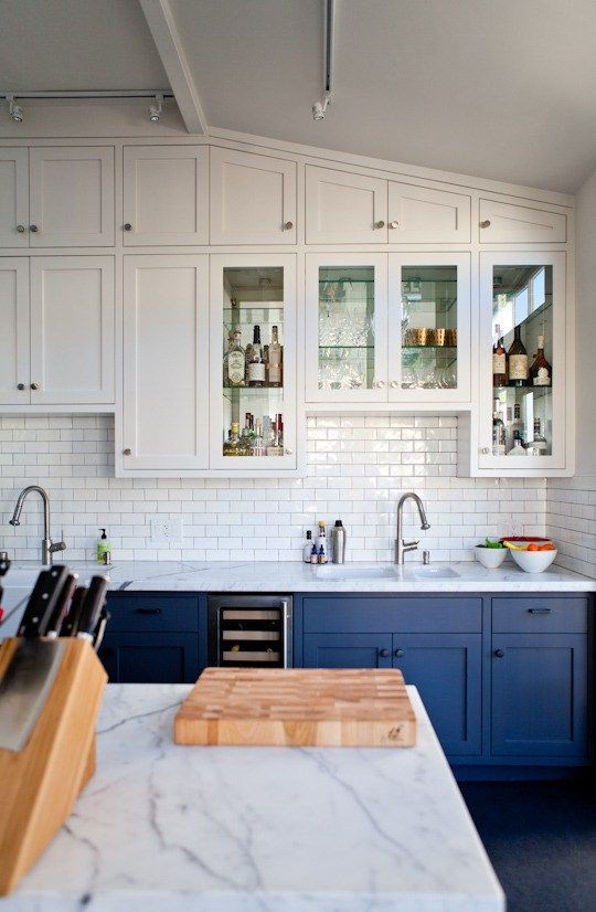 Recently, I find myself really inspired by two tone kitchen cabinets with white uppers and varying shades of lower cabinet colors. Check out these ideas!: