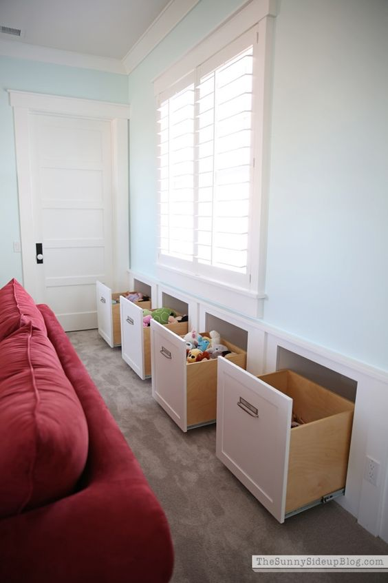 Organized playroom! A room designed with toy organization in mind. These extra large drawers look like part of the wainscot but actually pull out for more hidden toy storage! (Sunny Side Up):