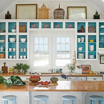 Love the open shelving with the dark color back wall in the cabinets & on the shelves!:
