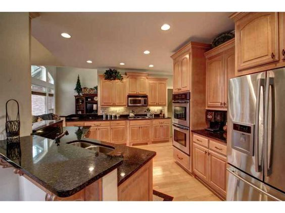 kitchen: stainless steel, dark granite counter tops, light ... on Light Maple Kitchen Cabinets With Granite Countertops  id=25490