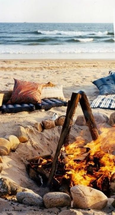 The beach is a pretty classic place for a picnic. There is something magical about a fire pit and the ocean breeze.: