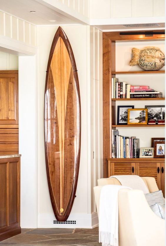 A beautiful wooden surfboard as living room wall art!