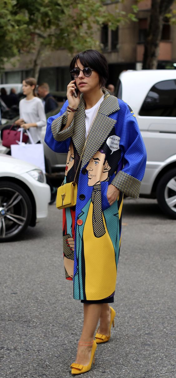 Wrapped up in pop art during Milan Fashion Week. (Photo: Lee Oliveira for The New York Times):