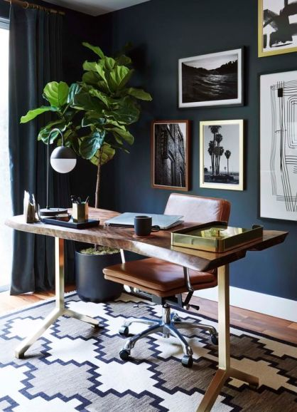 I think we could all get a lot of work done in this moody nid century home office: