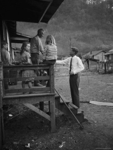 John F. Kennedy meets a family in West Virginia while campaigning for president.: