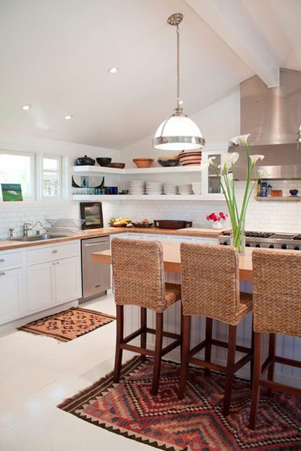 Dreamy kitchen: bright, white cabinetry, open shelving, natural material bar chairs...and KILIM RUGS!!! :):