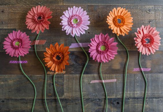 Make Your Own Paper Gerbera Daisies • Free tutorial with pictures on how to make a paper flower in under 120 minutes: