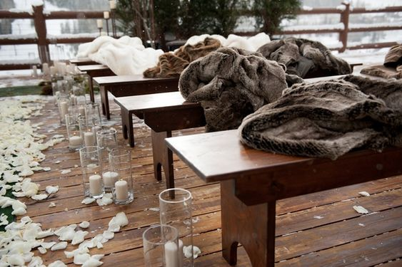 Wintry Ceremony Seating Photography: Handeland Tesoro Photography Read More: http://www.insideweddings.com/weddings/snowy-outdoor-winter-ceremony-cozy-lodge-reception/522/:
