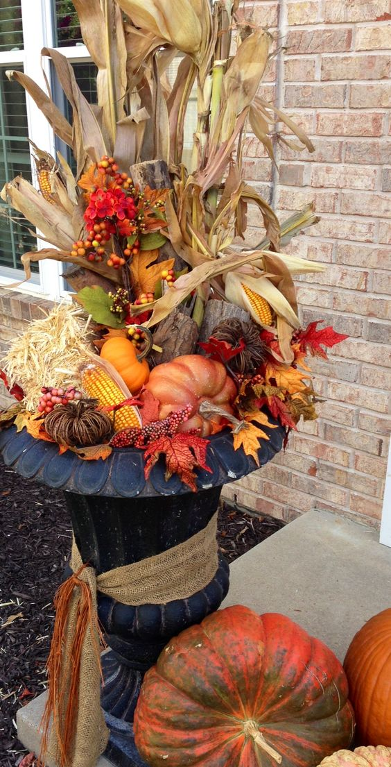Fall arrangement - I use the artificial outdoor Christmas tree stands for my base. This way they are already in place for me to switch out the Autumn decor for Christmas at the end of November. Easy peasy transition!: