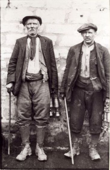 1900 work clothes | wall; both men are middle-aged and are dressed in work clothes ...: