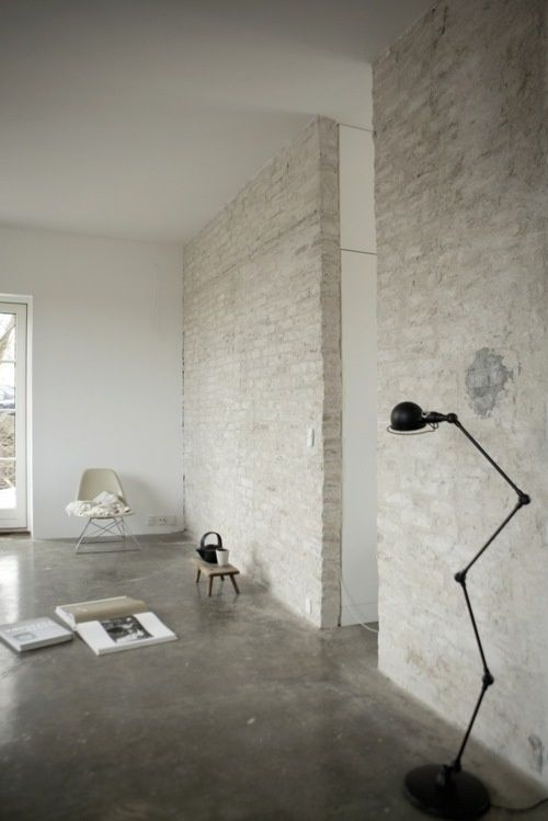 Polished Concrete Floors And White Washed Brick Make This