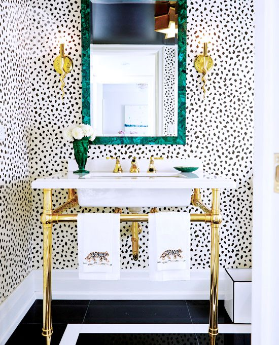 I love the look of stand alone washstands over built in cabinets, it offers an eclectic, Parisian feel. #layeredny Dour a Design Editor's Own Bold Digs//brass washstand, malachite mirror: