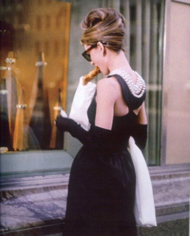 "Audrey Hepburn in 'Breakfast at Tiffany's'. Holly Golightly: ""He's alright! Aren't you, cat? Poor cat! Poor slob! Poor slob without a name! The way I see it I haven't got the right to give him one. We don't belong to each other. We just took up one day by the river. I don't want to own anything until I find a place where me and things go together. I'm not sure where that is but I know what it is like. It's like Tiffany's."":"
