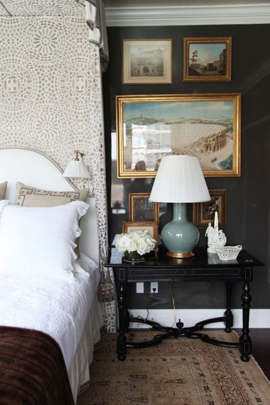 LittleGreenNotebook.blogspot.com: nightstand arrangement  black walls, gold frames, celadon lamp, black nightstand, white bed linens: