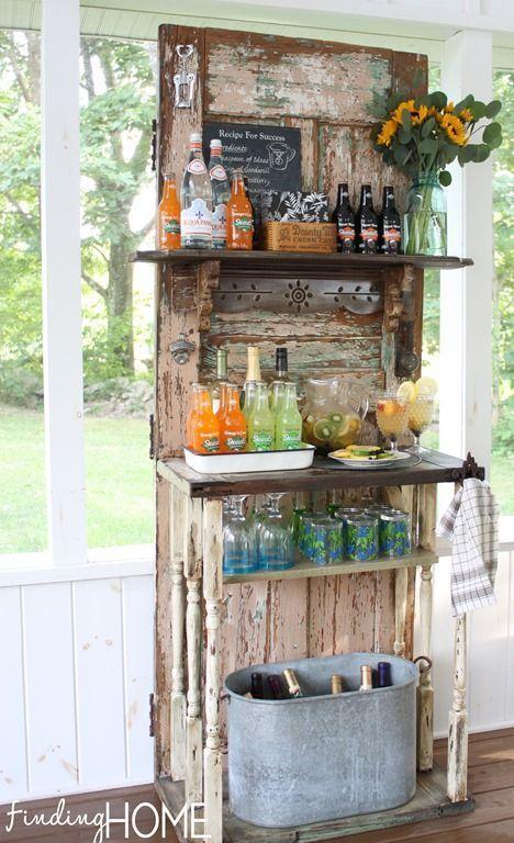 DIY outdoor, backyard, garden party Beverage Bar Station using a recycled door with added shelves. Notice the bottle opener near the top left of the door.