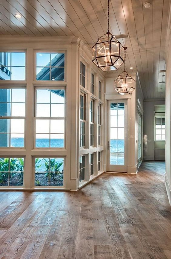 Beach house with reclaimed hardwood floors   Urban Grace Interiors by delia:
