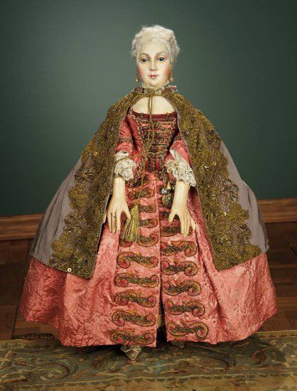 18th Century Venetian Court Doll, circa 1780. Silk damask open robe, silk faille cape, stockings with knee garters, brocade heeled shoes, accessories including black domino and bauta masks, and tricorn.: