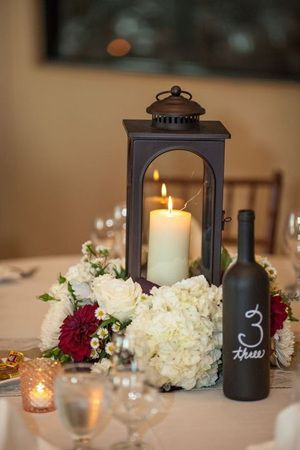 candle and lantern winter wedding centerpiece ideas:
