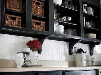 Open cabinetry to expand the feeling of a small kitchen. Black, brown, cream, white.: