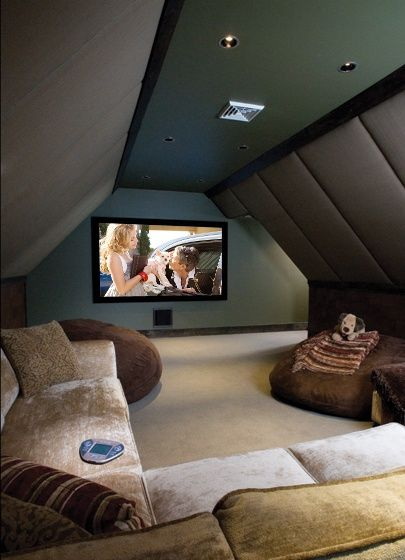 An attic turned into a home theater room.: