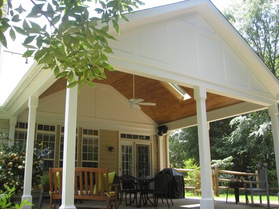 Screen Porch With Beadboard Roof And White Pillars