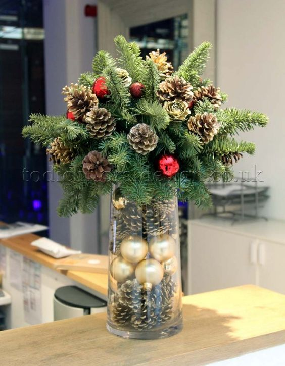 Tall vase centrepiece with baubles inside - Taller vase than this but similar effect and more mixed arrangement at the top - More: