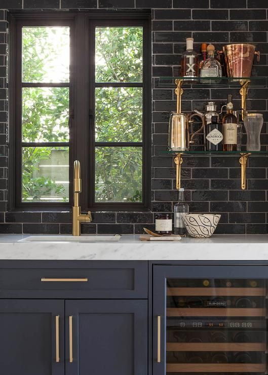 Black brick walls and blue cabinets and drawers with gold handles for kitchen design is beautiful   Kanler.com: