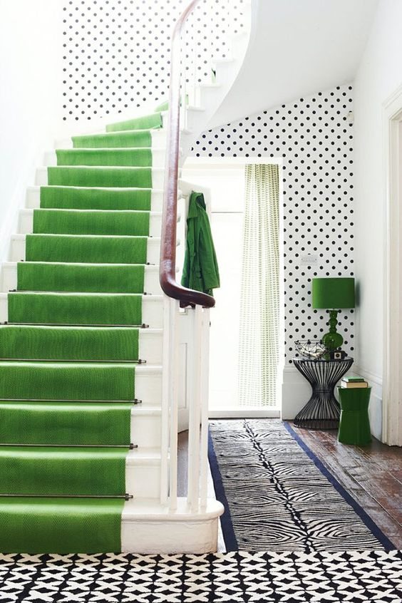 I'm not so much about the green staircase as I am the POLKA DOT WALLS... Shut the Front Door! 15 Unique Places to Add a Pop of Color to Your Home via Brit + Co.: