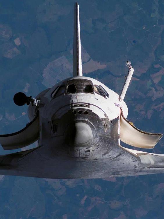 Space Shuttle in zero gravity orbit up away into space