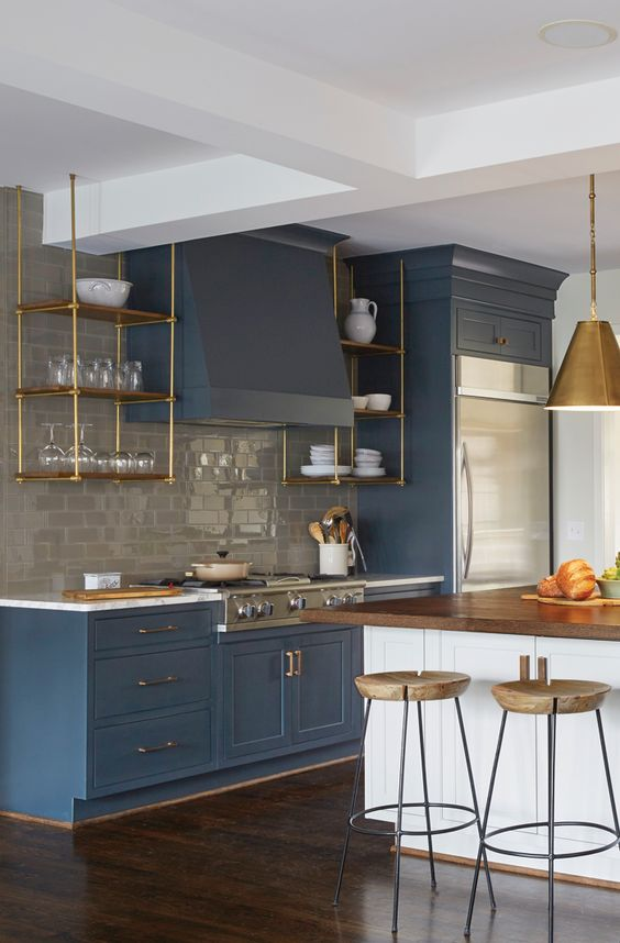 shelving stove paneling Slate blue cabinets with gold hardware: