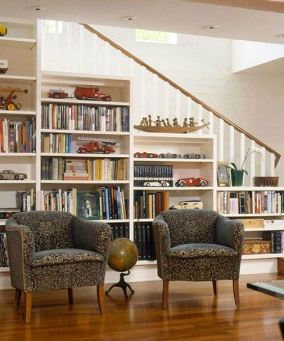 Clever use of space - shelves under the stairs to display books and fill up space - home library design:
