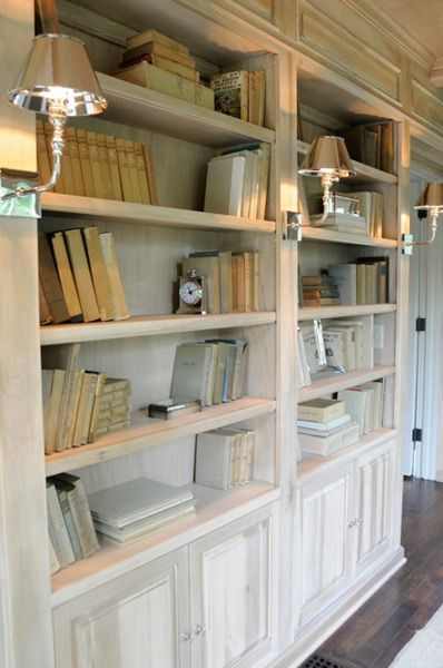 Pretty bookshelves with lower cabinets and sconces with ... on Corner Sconce Shelf Cabinet id=78614