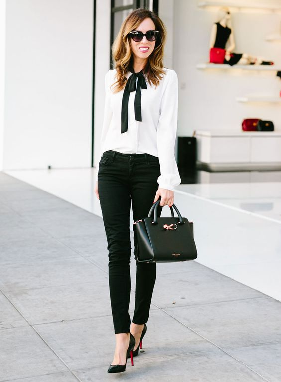 Sydne Style - Los Angeles fashion blogger and People StyleWatch contributor Sydne Summer shows how to wear black jeans with a bow blouse at the office.: