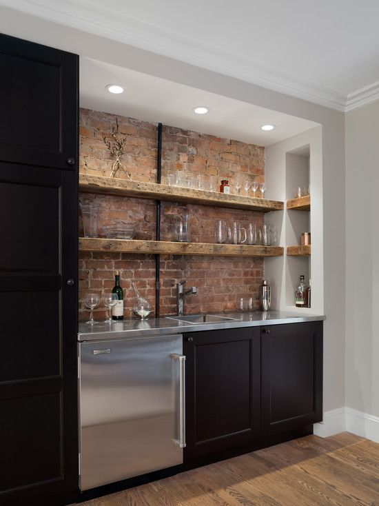 ... With Backsplash And Sink Also Various Glass In Cabinets And Brick Wall: