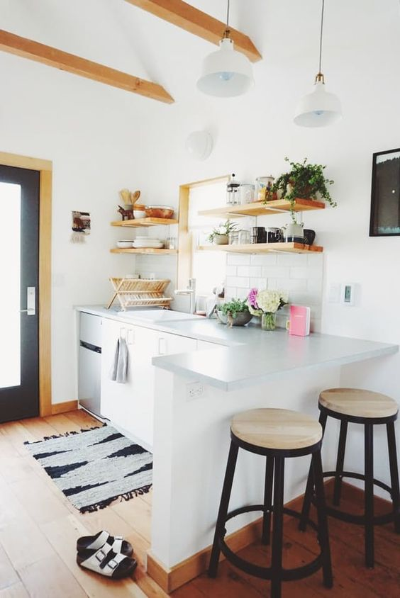 Name: Genevieve Location: Concordia — Portland, Oregon This is our tiny house (216 square feet) within the growing Concordia neighborhood in NE Portland. The home started as a garage space that was historically permitted as a living space in the 1940s under WWII war time code. So, the tiny house itself has some interesting history.: