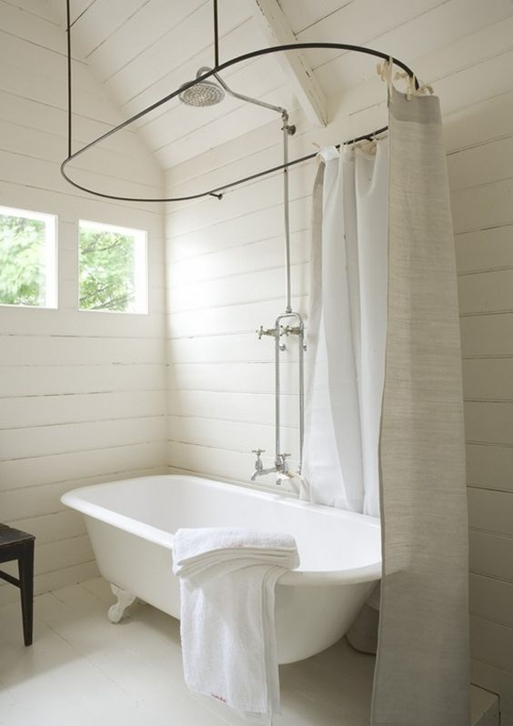 perfect claw foot tub and shower, love the shower head in the middle... if the windows were bigger it would be my dream come true !!!!: